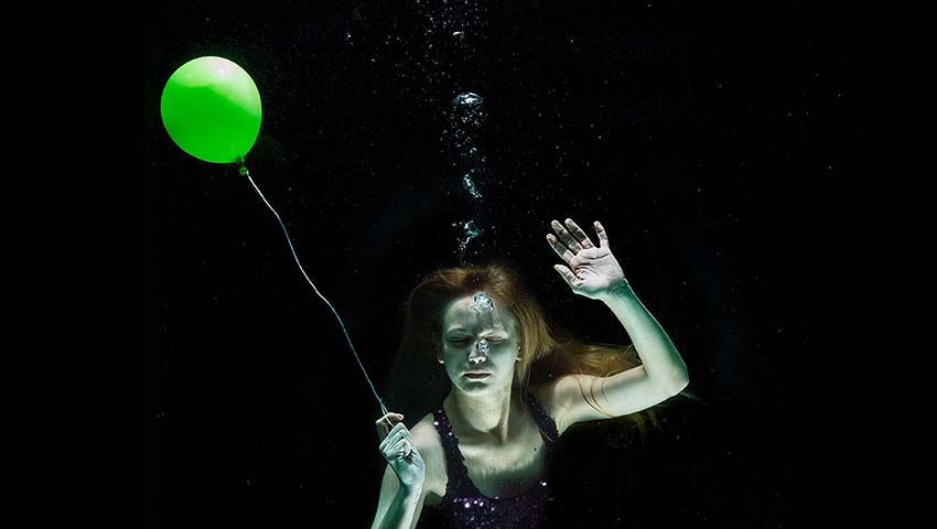 Woman Underwater with Balloon