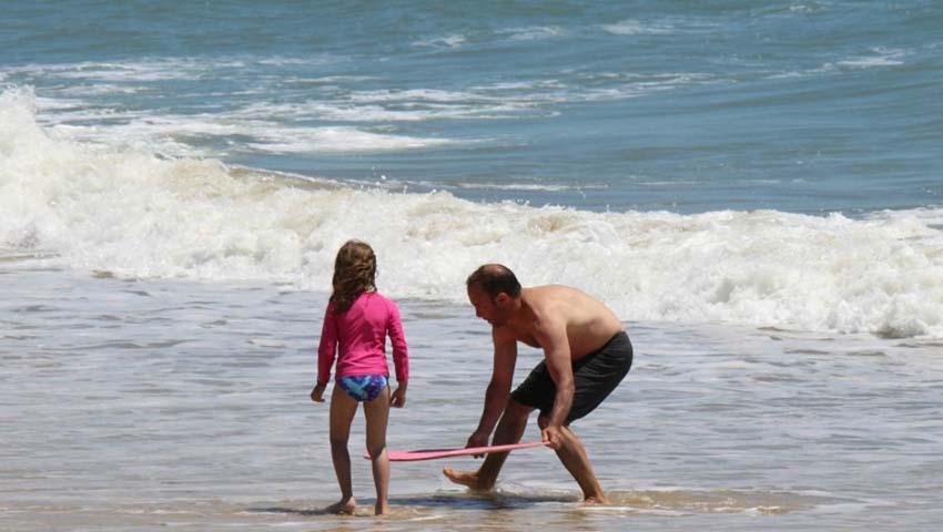 man and girl on the beach